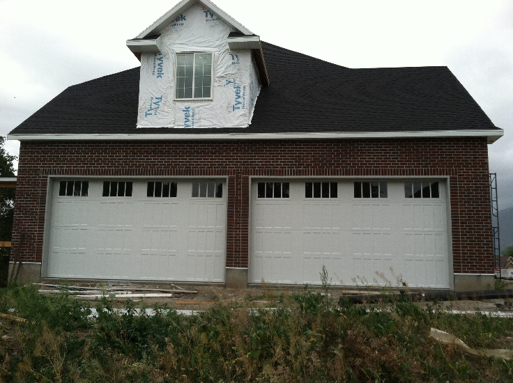 White Garage Doors on New House