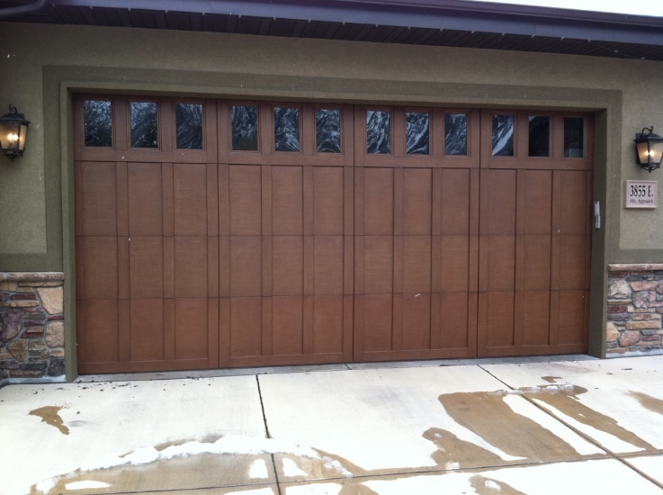 Wooden garage door sales service ut a plus garage doors for Best wood for garage doors