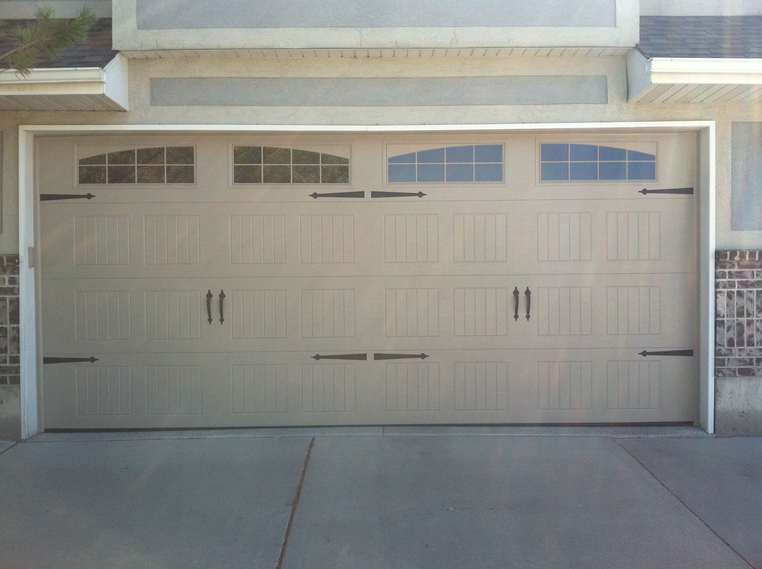New door sales installation a plus garage doors for Garage door repair roy utah