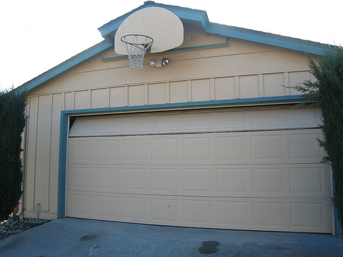 Things to consider when buying a new garage door a for Garage door repair west jordan utah