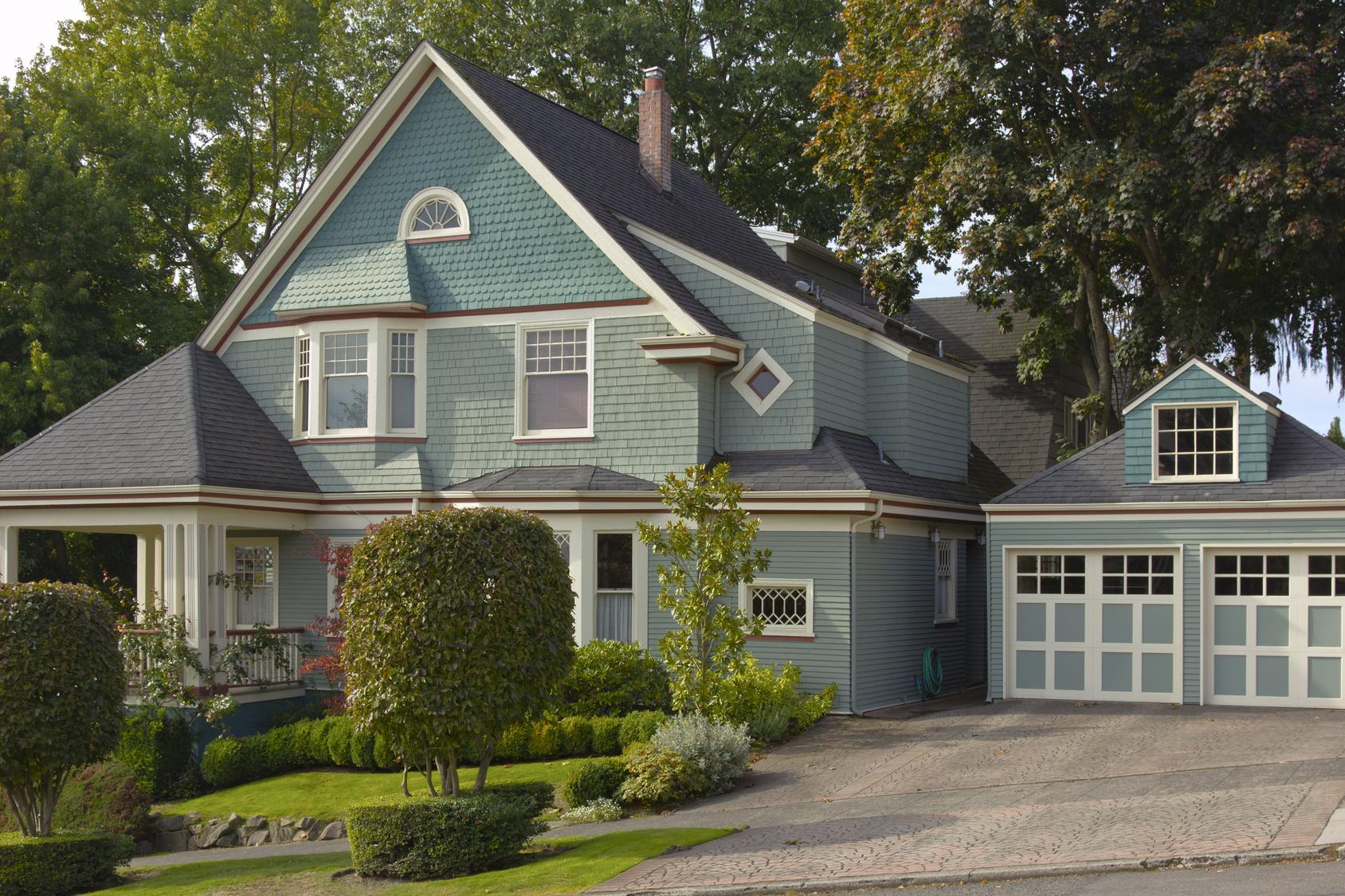 blue house blue garage doors