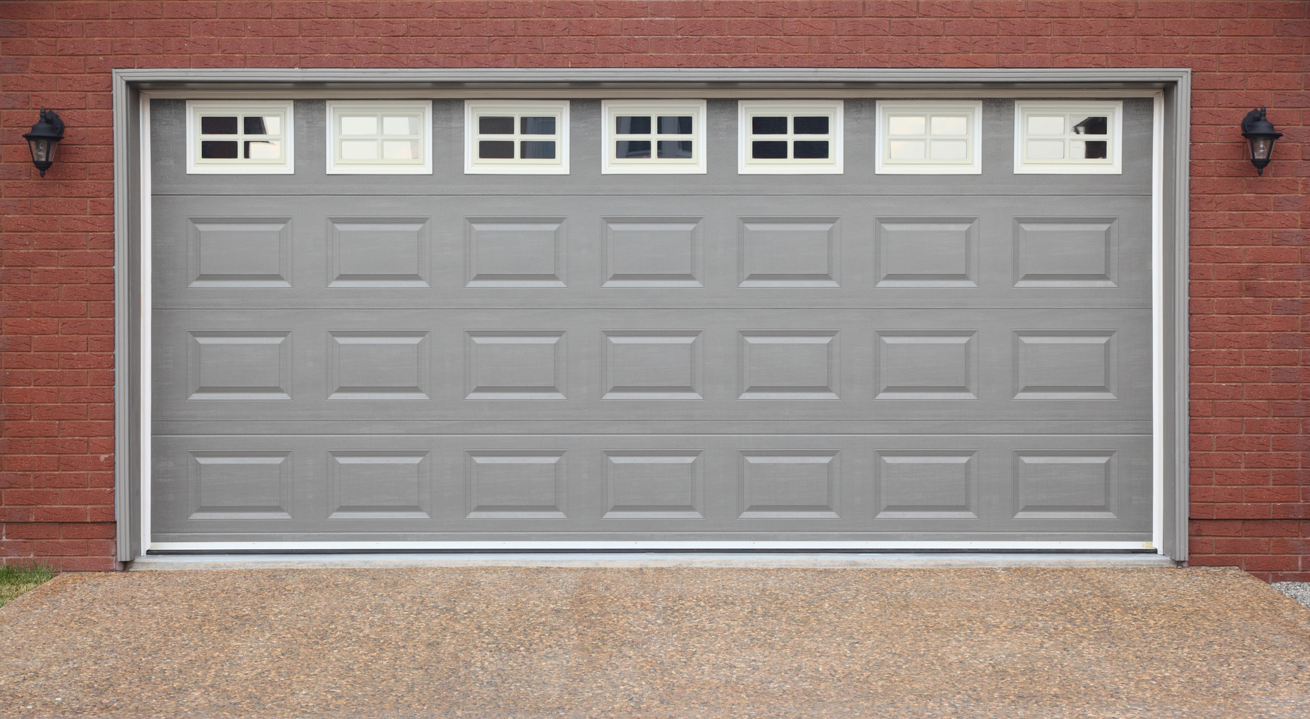 When to repair vs replace your garage door a garage doors for Garage door repair roy utah