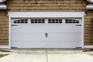 Paneled wooden garage door home
