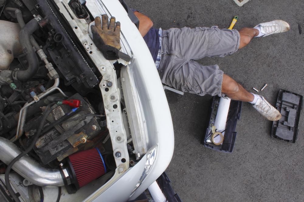 Man fixing car in garage
